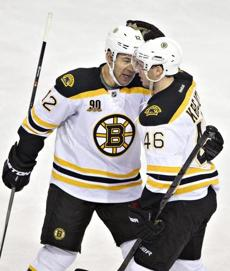 Jarome Iginla (left) earned the approval of David Krejci after one of his two goals Thursday.